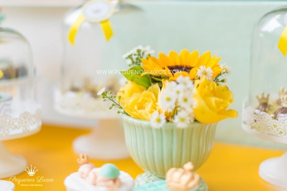 yellow and white flower decorations fpr little prince crown baby shower