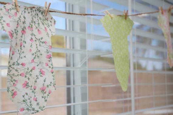 the-secret-garden-baby-shower-floral-onesie-decorations