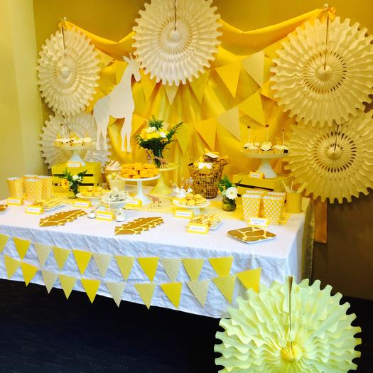 Bright Yellow Giraffe Baby Shower desser table floral papers