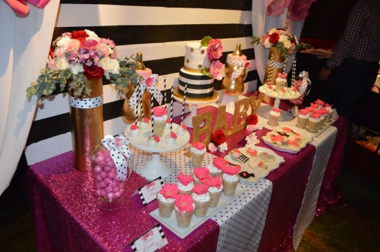 Kate Spade Inspired Baby Shower dessert table in black and white stripes backdrop, hot pink and gold