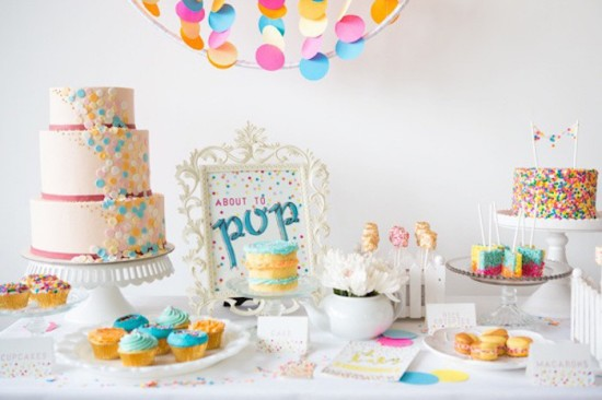 baby sprinkle dessert table and confetti pennants