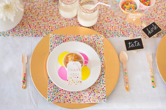 baby sprinkle table setup with favor on plate