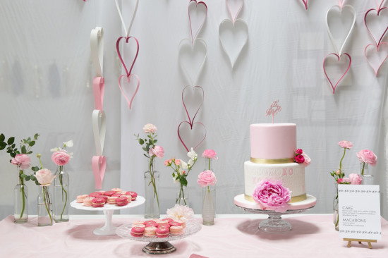 Sweet XOXO Baby Shower dessert table with cake in pink