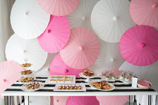 Sweet XOXO Baby Shower food table with parasol backdrop