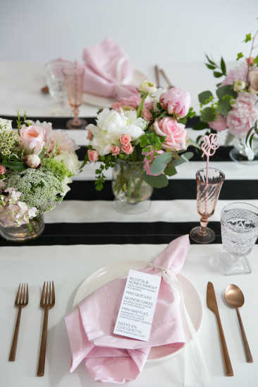 Sweet XOXO Baby Shower guest table setting with florals