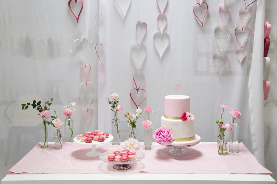 dessert table with hanging paper hearts