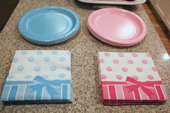 Little Man or Little Lady Gender Reveal table setting for blue and pink bows