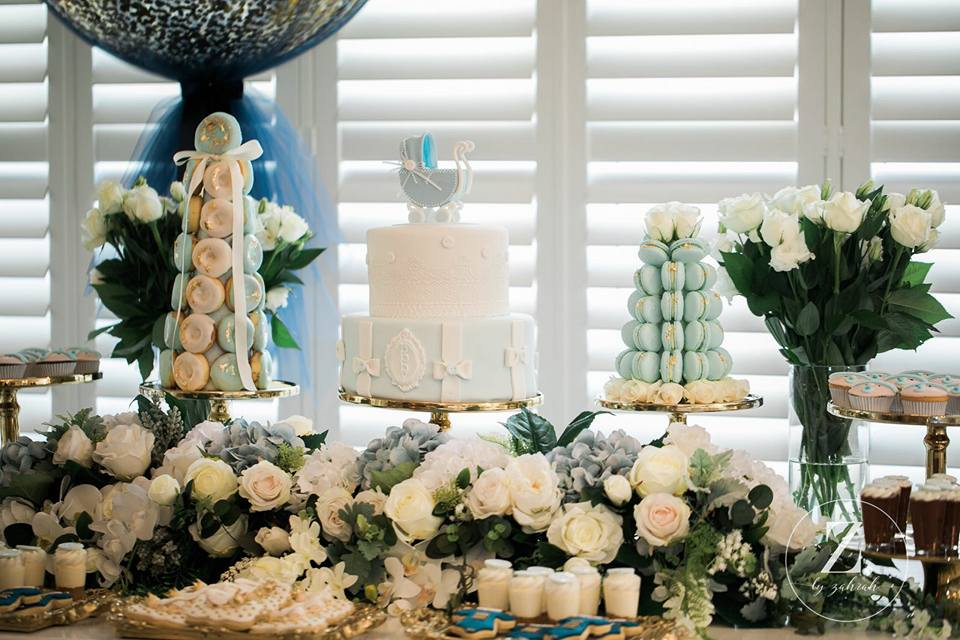 elegant-boy-baby-shower-cake-with-baby-carriage-topper