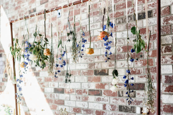 flowers-hanging-over-dessert-bar