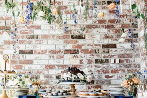 flowers-hanging-over-dessert-bar-nicely