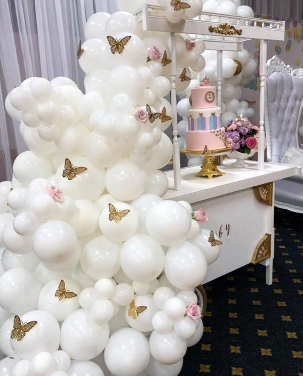 gold-butterfly-on-white-balloon-arch