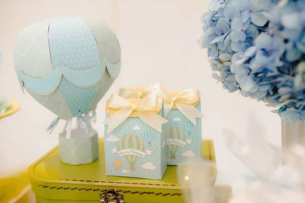 blue hot air balloon paper decorations and favor boxes