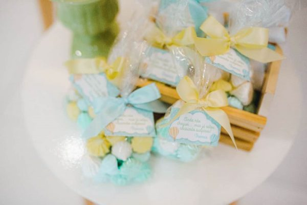 sweet bags with blue and yellow ribbons
