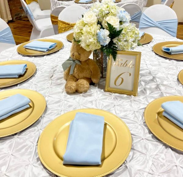 teddy bear with blue ribbon centerpiece for table