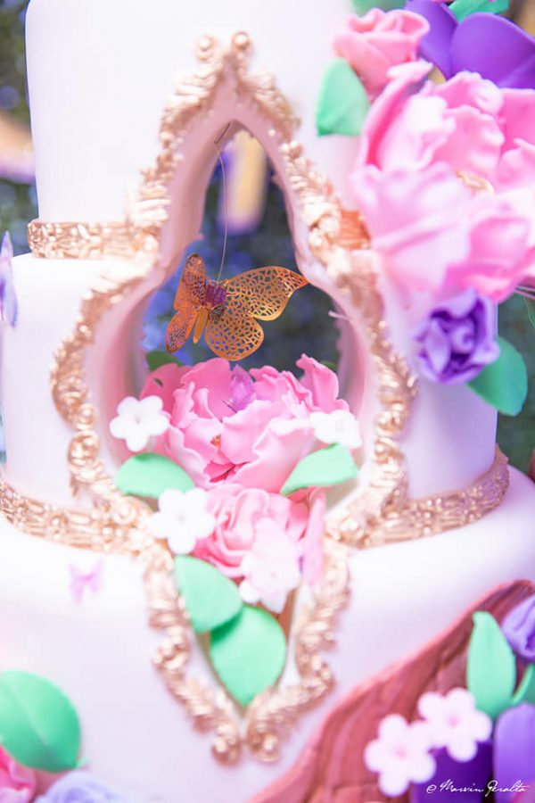cake with gold butterfly opening