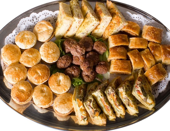 simple tray of food pies, meatballs, sandwiches