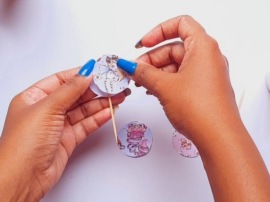 assemble cupcake wrapper and topper