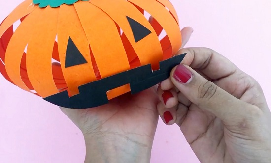 video on making paper pumpkin- add eyes and mouth