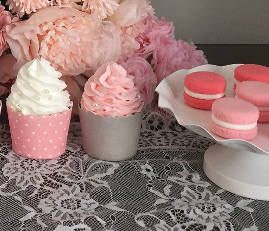 pink and white frosted cupcakes