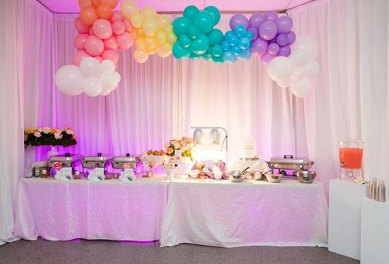 balloon rainbow over the food table