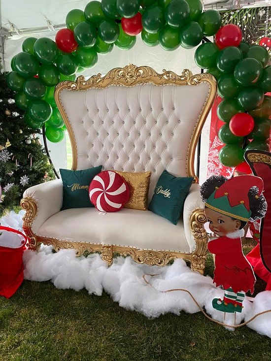 mommy throne chair under christmas balloon arch