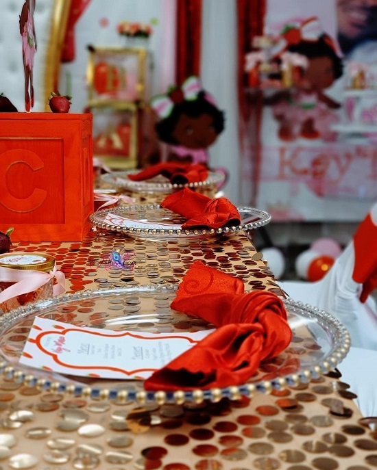 shimmering gold and red Strawberry shortcake table setup