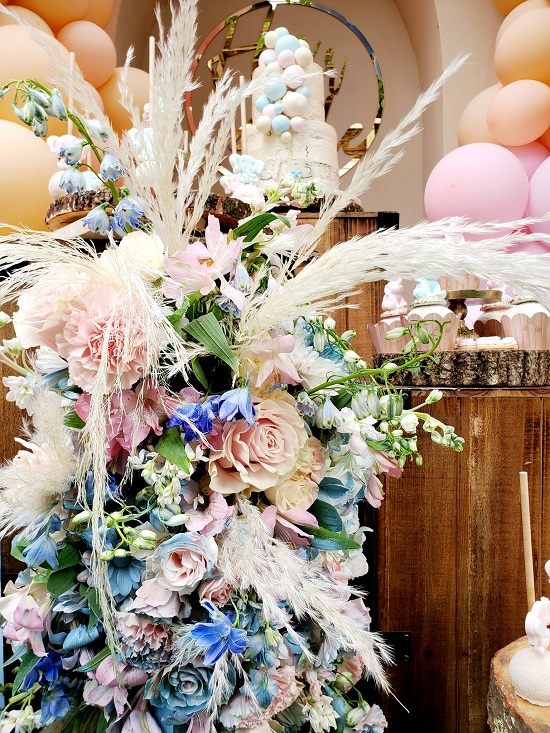 boho theme gender reveal flower arrangement