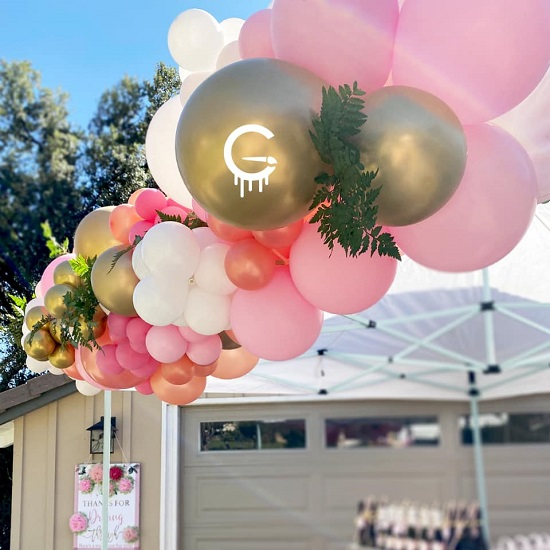 outdoor pink themed balloon arch