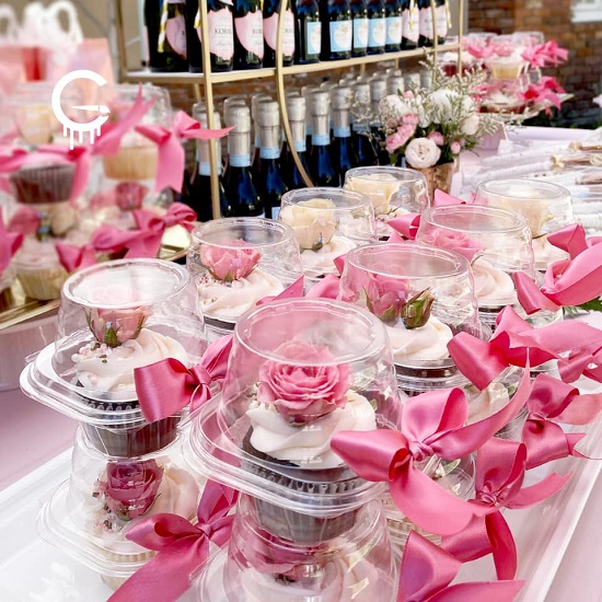 pretty pink flower topped cupcake favors
